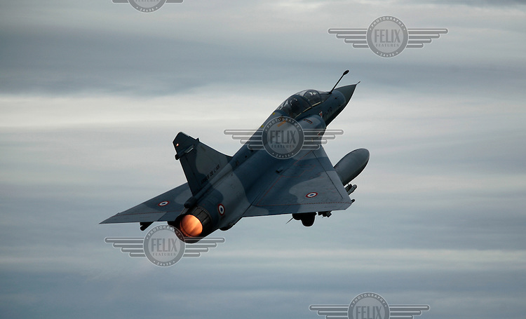 French Dassault-Breguet Mirage 2000 taking off with afterburner. BOLD AVENGER 2007 (BAR 07), a NATO  air exercise at Ørland Main Air Station, Norway. BAR 07 involved air forces from 13 NATO member nations: Belgium, Canada, the Czech Republic, France, Germany, Greece, Norway, Poland, Romania, Spain, Turkey, the United Kingdom and the United States of America. The exercise was designed to provide training for units in tactical air operations, involving over 100 aircraft, including combat, tanker and airborne early warning aircraft and about 1,450 personnel.