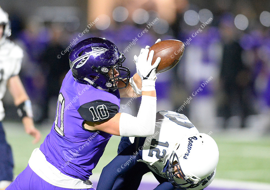 Waunakee's Austin Keller comes up with a catch over Reedsburg's Zobel Jon, as Reedsburg takes on Waunakee in Wisconsin Badger North Conference high school football at Waunakee High School on Friday, 9/28/18