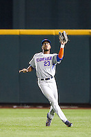 Florida Gators outfielder Buddy Reed (23) makes a catch during the NCAA College baseball World Series against the Virginia Cavaliers on June 15, 2015 at TD Ameritrade Park in Omaha, Nebraska. Virginia defeated Florida 1-0. (Andrew Woolley/Four Seam Images)