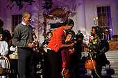 United States President Barack Obama and First Lady Michelle Obama hand out Halloween treats to children on the North Portico of the White House,  Sunday, October 31, 2010.  .Mandatory Credit: Pete Souza - White House via CNP
