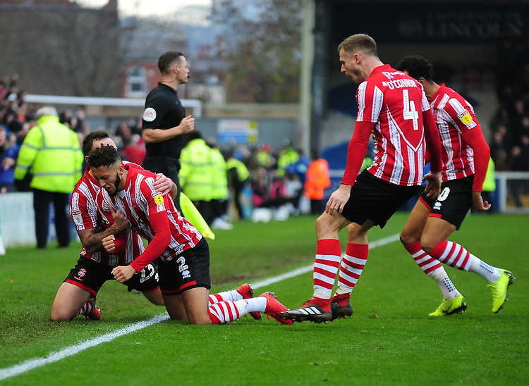 Lincoln City's Kellan Gordon celebrates scoring the opening goal with team-mates<br /> <br /> Photographer Andrew Vaughan/CameraSport<br /> <br /> The EFL Sky Bet League Two - Lincoln City v Mansfield Town - Saturday 24th November 2018 - Sincil Bank - Lincoln<br /> <br /> World Copyright © 2018 CameraSport. All rights reserved. 43 Linden Ave. Countesthorpe. Leicester. England. LE8 5PG - Tel: +44 (0) 116 277 4147 - admin@camerasport.com - www.camerasport.com