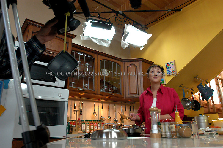 "3/25/2004--Beijing, China..Victoria 'JoJo' Zhou on the set of her TV show ""JoJo Good Living"" in Beijing. Zhou is sometimes compared to Martha Stewart as she attempts to introduce a middle class lifestyle to China.                                 ..Photograph by Stuart Isett.©2004 Stuart Isett. All rights reserved"