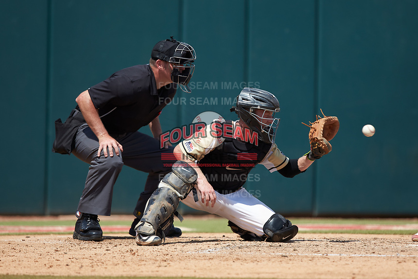 Army Black Knights catcher Jon Rosoff (7) prepares to catch a pitch as home plate umpire Mike Jarboe looks on during the game against the North Carolina State Wolfpack at Doak Field at Dail Park on June 3, 2018 in Raleigh, North Carolina. The Wolfpack defeated the Black Knights 11-1. (Brian Westerholt/Four Seam Images)