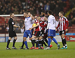 Tom Pope of Bury screaming at Referee Ross Joyce after his team mate Jacob Mellis was shown a red card at during the English Football League One match at Bramall Lane, Sheffield. Picture date: November 22nd, 2016. Pic Jamie Tyerman/Sportimage