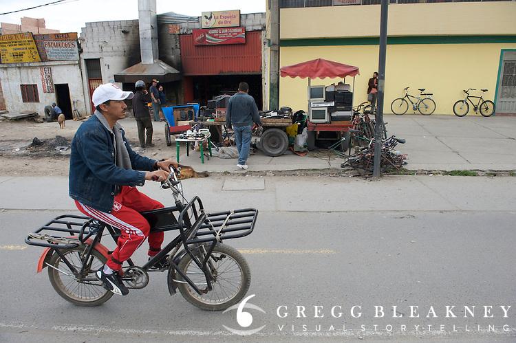 Utility bicycle commuter on the Alameda El Porvenir bike line - Bogota - Colombia