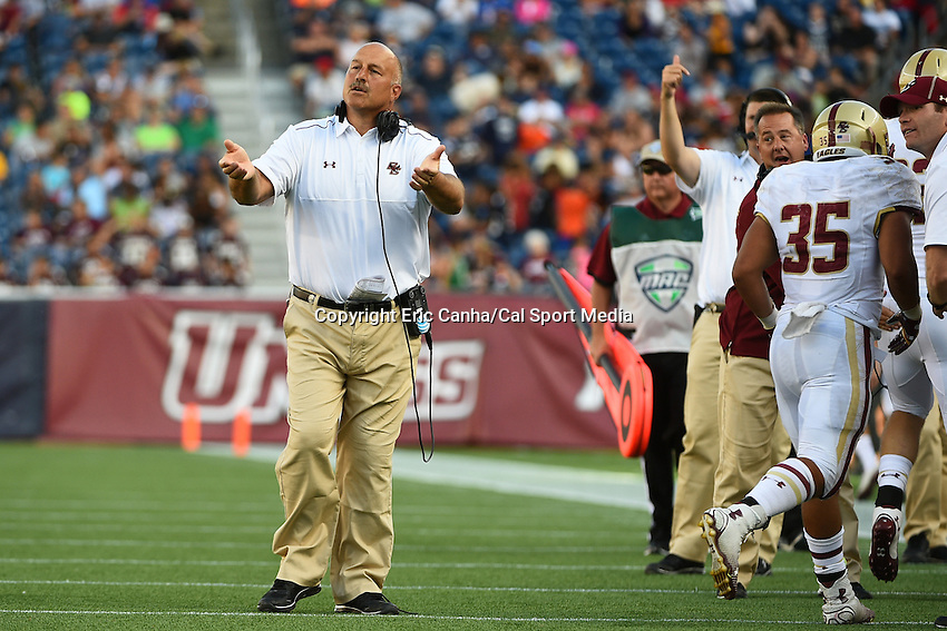 August 30, 2014 - Foxborough, Massachusetts, U.S. - Boston College Eagles head coach Steve Addazio calls the team off the field after scoring a touchdown during the NCAA Division I football game between Boston College Eagles and the University of Massachusetts Minutemen held at Gillette Stadium in Foxborough Massachusetts.  Boston College defeated The Minutemen 30-7. Eric Canha/CSM