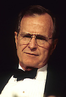 Washington DC., USA,  May 1992<br /> President George H.W. Bush. in Black tie at the White House Correspondents dinner. Credit: Mark Reinstein/MediaPunch
