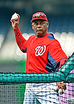 16 May 2012: Washington Nationals batting practice coach Jose Martinez throws prior to game action against the Pittsburgh Pirates at Nationals Park in Washington, DC. The Nationals defeated the Pirates 7-4 in the first game of their 2-game series. Mandatory Credit: Ed Wolfstein Photo