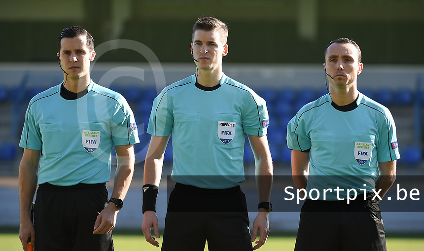 20170323 - BEVEREN , BELGIUM : Referee Francois Letexier (M) with assistant referees Cyril Mugnier (R) and Mircea Grigoriu (L) pictured during the UEFA Under 19 Elite round game between Sweden U19 and Belgium U19, on the first matchday in group 7 of the Uefa Under 19 elite round in Belgium , thursday 23 th March 2017 . PHOTO SPORTPIX.BE | DIRK VUYLSTEKE