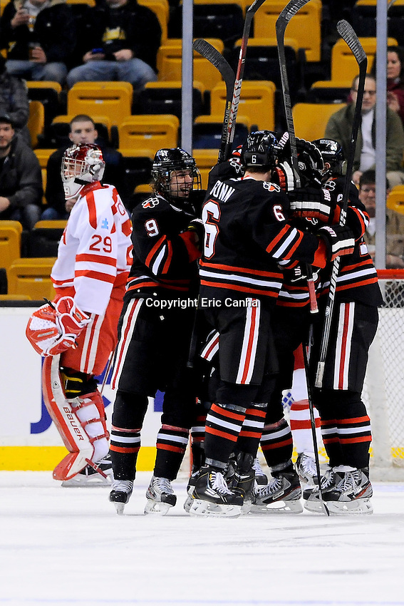 Northeastern University Huskies celebrate a goal during the first semi-final Beanpot Tournament hockey game between Bosto University and Northeastern University held at TD Garden in Boston Massachusetts.  Eric Canha/CSM
