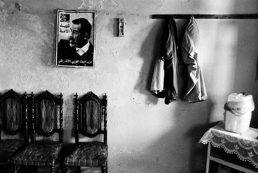 A poster of Saddam Hussein hangs in the home of an Iraqi familiy, Amman, Jordan, August 2009. Photo: Ed Giles.