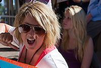 "Charlie (foreground) takes part in a chant while sitting in front of a Bank of America as a portion of the Occupy Orange County, Irvine's march on Saturday November 5. The chant is ""I am the 99%, you are the 99%, we are the 99%"", and she's currently illustrating the ""I am the 99%"" portion."