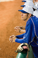 20 August 2007: Pitcher Matthieu Brelle Andrade watchs the game from the dugout during the Czech Republic 6-1 victory over France in the Good Luck Beijing International baseball tournament (olympic test event) at the Wukesong Baseball Field in Beijing, China.