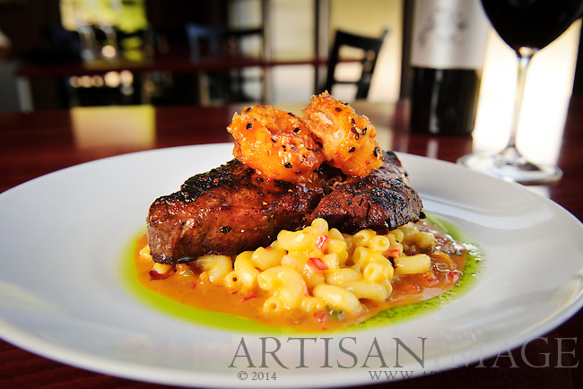 Blackened NY strip and general tso's shrimp over mac-n-cheese and an almond, leek, pepper, and onion szechwan sauce. (Photo/Artisan Image, Inc.)