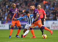 Huddersfield Town's Juninho Bacuna tries to find a way past Manchester City's Nicolas Otamendi<br /> <br /> Photographer Dave Howarth/CameraSport<br /> <br /> The Premier League - Huddersfield Town v Manchester City - Sunday 20th January 2019 - John Smith's Stadium - Huddersfield<br /> <br /> World Copyright © 2019 CameraSport. All rights reserved. 43 Linden Ave. Countesthorpe. Leicester. England. LE8 5PG - Tel: +44 (0) 116 277 4147 - admin@camerasport.com - www.camerasport.com