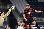 11 December 2015: Stanford's Jordan Morris (13) watches as Akron's Jake Fenlason (left) punches the ball away. The Akron University Zips played the Stanford University Cardinal at Sporting Park in Kansas City, Kansas in a 2015 NCAA Division I Men's College Cup Semifinal match. (Photograph by Andy Mead/YCJ/Icon Sportswire)