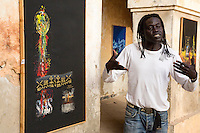 "Artist ""Mr. Co"" (Corentin Faye) Explains his Painting, Biannual Arts Festival, Goree Island, Senegal."