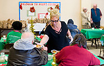 WATERBURY, CT-122517JS09---Volunteer Nicki Maiorano of Waterbury, serves desserts to guests during the annual Joy of Christmas Dinner served on Christmas Day at the First Congregational Church's Clinton Hall in Waterbury. <br /> Jim Shannon Republican-American