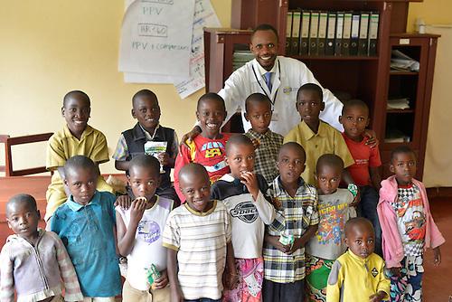 Pediatric HIV outpatients with Patric Irenge, Acting Director, at Kibuye Hospital, Karongi District, Western Rwanda