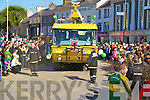 Kerry Airport fire personnel guide their fire appliance through the huge crowds that turned out to watch the parade in Killarney on Tuesday. ....