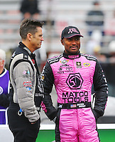 Oct 3, 2015; Mohnton, PA, USA; NHRA top fuel driver Larry Dixon (left) talks with Antron Brown during qualifying for the Keystone Nationals at Maple Grove Raceway. Mandatory Credit: Mark J. Rebilas-USA TODAY Sports