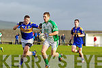 Ronan Kerin of St Senans trys to stop the advance of Ballyduff's Paud Costello in his penalty in The Bernard O'Callaghan Memorial Senior Football Championship quarter final replay last Sunday in Bob Stack Park, Ballybunion.