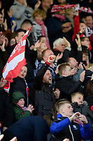 Lincoln City fans celebrate their teams goal, scored by Shay McCartan<br /> <br /> Photographer Chris Vaughan/CameraSport<br /> <br /> The EFL Sky Bet League Two - Lincoln City v Cheltenham Town - Saturday 13th April 2019 - Sincil Bank - Lincoln<br /> <br /> World Copyright © 2019 CameraSport. All rights reserved. 43 Linden Ave. Countesthorpe. Leicester. England. LE8 5PG - Tel: +44 (0) 116 277 4147 - admin@camerasport.com - www.camerasport.com