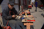 street vendor/carpenter <br /> outside the Qiao Family Courtyard<br /> Shanxi, China