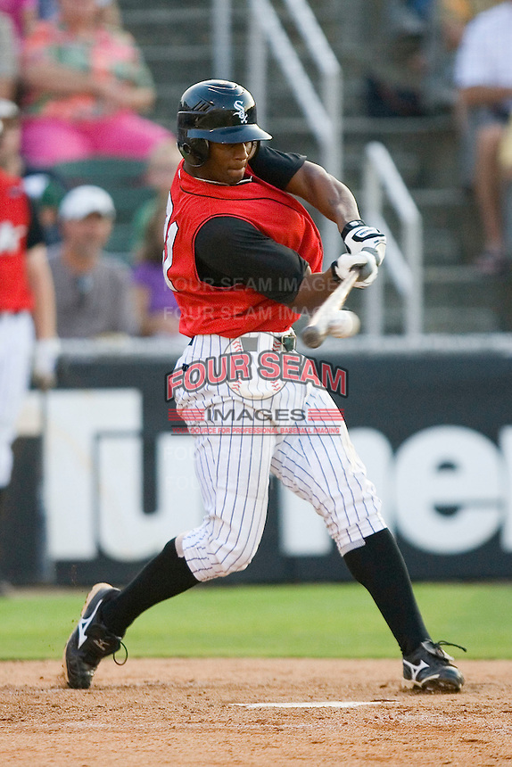 Sergio Morales #21 of the Kannapolis Intimidators makes contact with the baseball at Fieldcrest Cannon Stadium July 25, 2009 in Kannapolis, North Carolina. (Photo by Brian Westerholt / Four Seam Images)