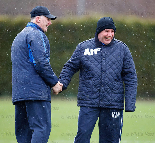 Ally McCoist laughing after he uses strips of white tape to mark his initials on his jacket, Jim Stewart is ripping the pish