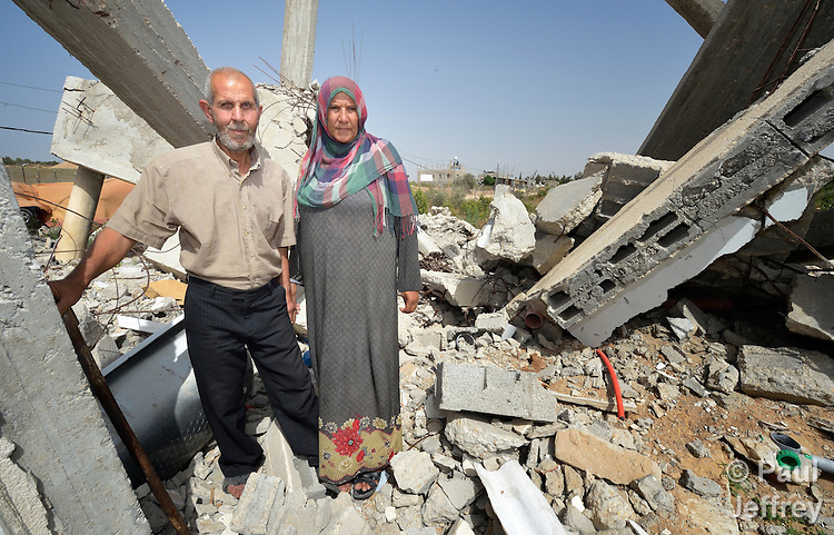 Najeeb Zaneen and Moyasar El Za'anen stand in the rubble of their home in Beit Hanoun, Gaza, which was destroyed by an Israeli air strike in 2014. They have received help in reestablishing their farm from International Orthodox Christian Charities, a member of the ACT Alliance.
