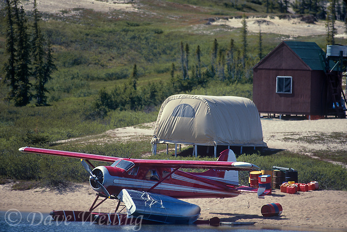 731000205 a dehavillan beaver pontoon-equipped aircraft sits at the edge of whitefish lake at the remote campsite for whitefish lake in the northwest territories