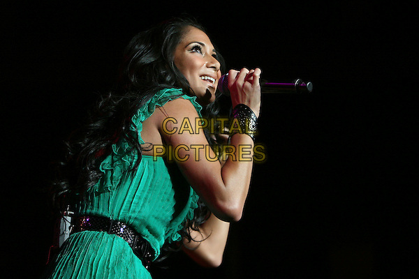 NICOLE SCHERZINGER.Performs at The 1st Annual 102.7 KIIS FM Homecoming Concert held at The Honda Center  in Anaheim, LA, California, USA,  October 27 2007..half length green top microphone on stage gig concert.CAP/DVS.©Debbie VanStory/Capital Pictures