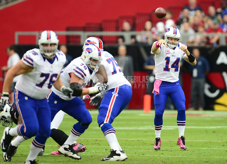 Oct. 14, 2012; Glendale, AZ, USA; Buffalo Bills quarterback (14) Ryan Fitzpatrick throws a pass in the first quarter against the Arizona Cardinals at University of Phoenix Stadium. Mandatory Credit: Mark J. Rebilas-