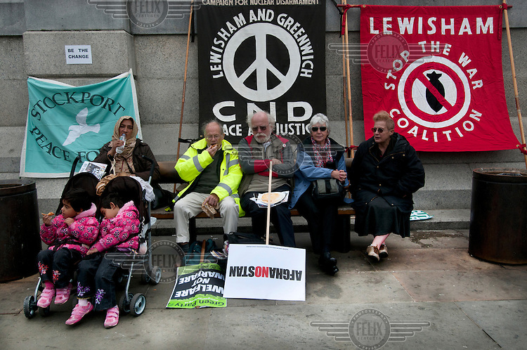 people attending a rally in London's Trafalgar Square organised by the Stop the War Coalition to mark 10 years of war in Afghanistan.
