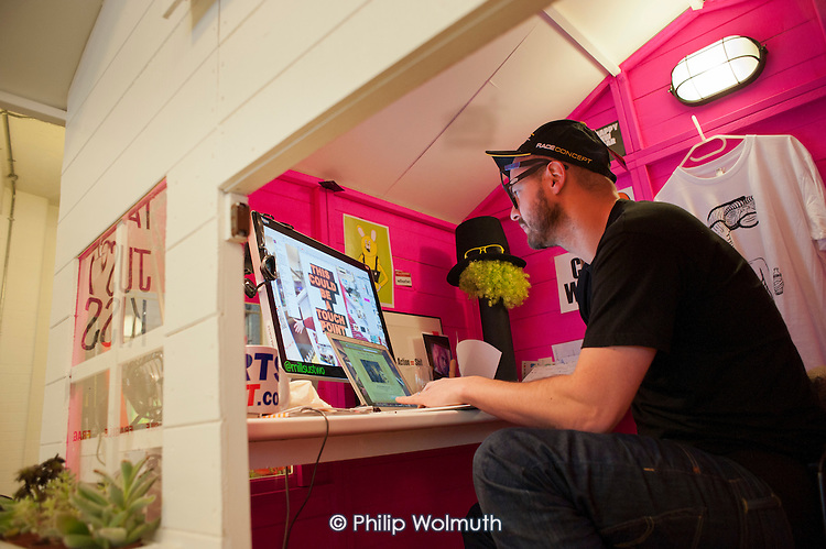 Mills, co-founder of ustwo, a mobile app developer based in Shoreditch, London, at work in his Wendy House office. The run-down commercial district also known as Silicon Roundabout, is undergoing gentrification as it becomes a centre for web-based companies and IT start-ups.