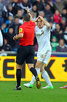 Saturday, 03 November 2012<br /> Pictured: Garry Monk of Swansea (R) reacts to the decision of match referee K Friend (L) to award a free kick to Chelsea just outside the Swansea box.<br /> Re: Barclays Premier League, Swansea City FC v Chelsea at the Liberty Stadium, south Wales.