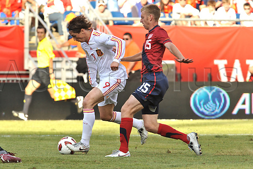 04.06.2011. Spain forward Fernando Torres (9) gets a hand on the back and a shove from United States defender Tim Ream (15) as he cuts the defense and scores during the Spain game against the USA at Gillette Stadium in Foxborough, MA
