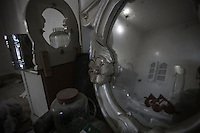 A house destroyed by mortar shelling is seen reflected in a mirror at the Al-Amarya neighborhood of the northern Sirian city of Aleppo.