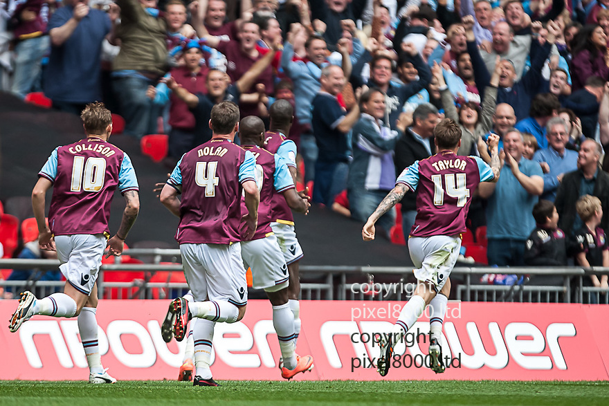 London, UK. West Ham striker celebrates his goal with teammates by running towards fans at opposite end during nPower Championship playoff final fixture Blackpool versus West Ham United at Wembley Stadium 19 May.  Please Byline David Fearn Pixel 8000 Ltd