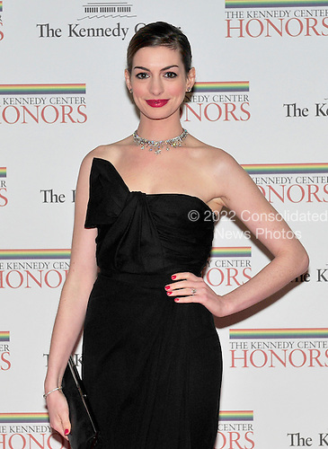 Anne Hathaway arrives for the formal Artist's Dinner honoring the recipients of the 2011 Kennedy Center Honors hosted by United States Secretary of State Hillary Rodham Clinton at the U.S. Department of State in Washington, D.C. on Saturday, December 3, 2011. The 2011 honorees are actress Meryl Streep, singer Neil Diamond, actress Barbara Cook, musician Yo-Yo Ma, and musician Sonny Rollins..Credit: Ron Sachs / CNP