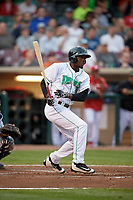 Dayton Dragons right fielder Michael Beltre (34) follows through on a swing during a game against the Cedar Rapids Kernels on May 10, 2017 at Fifth Third Field in Dayton, Ohio.  Cedar Rapids defeated Dayton 6-5 in ten innings.  (Mike Janes/Four Seam Images)