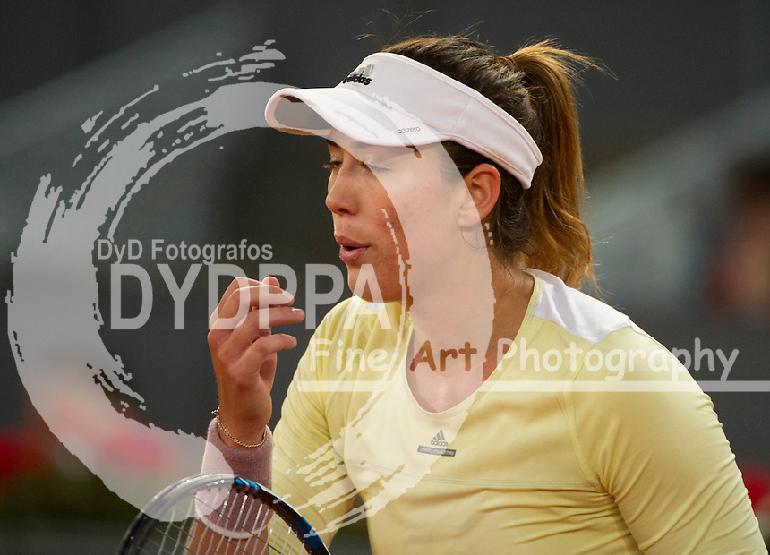 Spanish tennis player Garbine Muguruza returns the ball