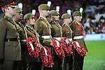 The Royal British Legion with Poppy Wreaths before the start of the FIFA World Cup Qualifying match at the Cardiff City Stadium, Cardiff. Picture date: November 12th, 2016. Pic Robin Parker/Sportimage