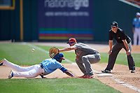 Lehigh Valley IronPigs first baseman Damek Tomscha (13) stretches for a pickoff attempt throw as Jonathan Davis (1) dives back to the bag with umpire Richard Riley looking on during an International League game against the Buffalo Bisons on June 9, 2019 at Sahlen Field in Buffalo, New York.  Lehigh Valley defeated Buffalo 7-6 in 11 innings.  (Mike Janes/Four Seam Images)