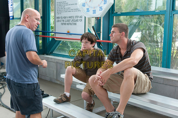 Director CHARLES MARTIN SMITH with NATHAN GAMBLE & AUSTIN STOWELL.on the set of Dolphin Tale.*Filmstill - Editorial Use Only*.CAP/FB.Supplied by Capital Pictures.