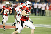 January 5th, 2008:  Ball State running back Chris Clancy (27) looks to cut as Rutgers defender Ron Girault (43) gives chase during the fourth quarter of the International Bowl at the Rogers Centre in Toronto, Ontario Canada...Rutgers defeated Ball State 52-30.  ..Photo By:  Mike Janes Photography