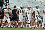 Torrance, CA 09/10/10 - Logan Okuda (Peninsula #25), Haden Gregory (Peninsula #42), Blake Allman (Peninsula #77) and Brock Dale (Peninsula #7)  in action during the Peninsula Panthers-North Saxons Varsity football game at North Torrance High School.