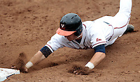 Virginia infielder Nick Howard (33) reaches back to first base during the game against Bucknell Friday at Davenport Field in Charlottesville, VA. Photo/The Daily Progress/Andrew Shurtleff