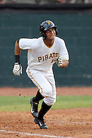 Left fielder Enyel Vallejo (12) of the Bristol Pirates in a game against the Greeneville Astros on Saturday, July 26, 2014, at DeVault Memorial Stadium in Bristol, Virginia. Greeneville won, 2-1 in Game 1 of a doubleheader. (Tom Priddy/Four Seam Images)